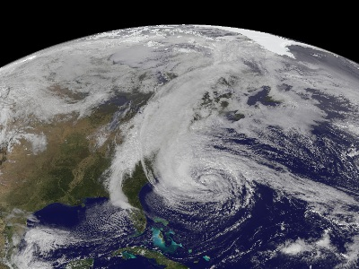 "An image of Hurricane Sandy taken by the GOES-13 satellite on October 28.  This category 1 <a href=""/earth/Atmosphere/hurricane/hurricane.html&edu=high"">hurricane</a> was huge, spanning a horizontal distance of about one-third the US continental landmass.  The storm came onshore in New Jersey, and gradually moved northeast.  The storm disrupted the lives of tens of millions in the eastern US, doing billions of dollars in damage, resulting in over 30 deaths.  Visit the National Hurricane Center's webpage on <a href=""http://www.nhc.noaa.gov/"">Hurricane Sandy</a> for details.<p><small><em>Image courtesy of NASA</em></small></p>"