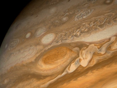 "This dramatic view of Jupiter's <a href=""/jupiter/atmosphere/J_clouds_GRS.html"">Great Red Spot</a> and its surroundings was obtained by <a href=""/space_missions/voyager.html"">Voyager 1</a> on Feb. 25, 1979, when the spacecraft was 5.7 million miles (9.2 million kilometers) from Jupiter. Cloud details as small as 100 miles (160 kilometers) across can be seen here. The colorful, wavy cloud pattern to the left of the Red Spot is a region of extraordinarily complex end variable wave motion.<p><small><em>Image courtesy of NASA</em></small></p>"
