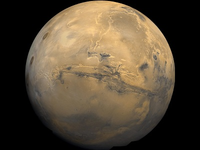 "The uniquely red <a href=""/mars/interior/Martian_global_geology.html&edu=elem"">global surface</a> of Mars is marked by many interesting features - some like those on the <a href=""/earth/earth.html&edu=elem"">Earth</a> and others strangely different. The reddish color is caused by rust (iron oxide) in the <a href=""/mars/exploring/martian_soils.html&edu=elem"">soil</a>.  Some of these features are; <a href=""/mars/interior/mars_volcanoes.html&edu=elem"">volcanoes</a>, canyon systems, <a href=""/mars/interior/Martian_running_water.html&edu=elem"">river beds</a>, <a href=""/mars/interior/Mars_cratered_terrain.html&edu=elem"">cratered terrain</a>, and <a href=""/mars/interior/Martian_dunefields.html&edu=elem"">dune fields</a>.  This image shows a global mosaic of 102 Viking 1 Orbiter images of Mars taken in February, 1980.<p><small><em>Image courtesy of NASA.</em></small></p>"