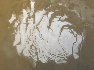 "This is a picture of the ice cap at the <a href=""/mars/places/mars_south_polar_region.html&edu=elem"">South Pole on Mars</a>. This picture was shot from Mars orbit in 2000 by a spacecraft called <a href=""/mars/exploring/MSG_overview.html&edu=elem"">Mars Global Surveyor</a>. The white regions are ice. Most of the ice is water ice, but there is also a thinner layer of dry ice (frozen carbon dioxide) on top of the water ice. The ice cap is about 420 km (260 miles) across.<p><small><em>Image courtesy of NASA/JPL/Malin Space Science Systems.</em></small></p>"